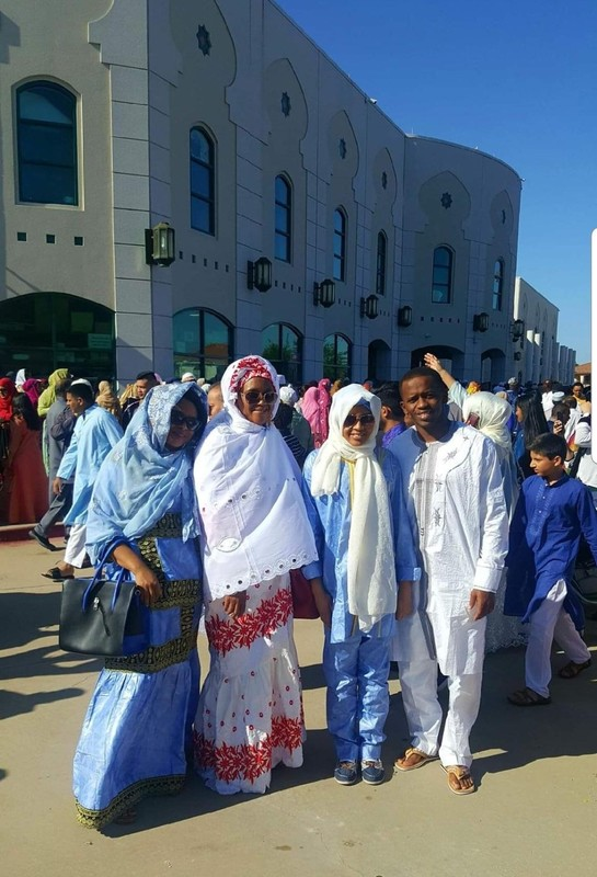 Algassimu Bah with his family during Friday prayers